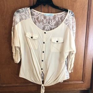 Tan shirt with lace back.